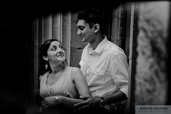Black and white engagement photo of Indian bride and groom.
