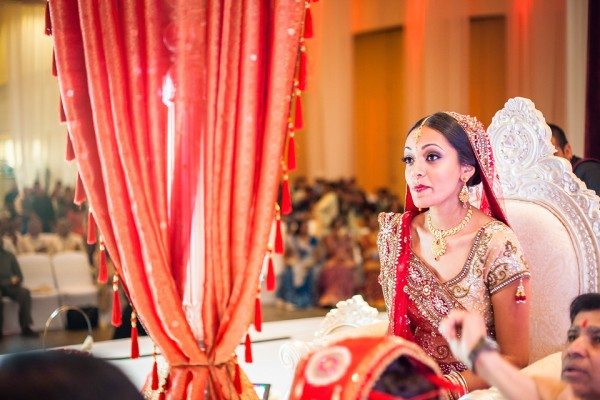 An Indian bride waits for her Indian groom at her Indian wedding ceremony.