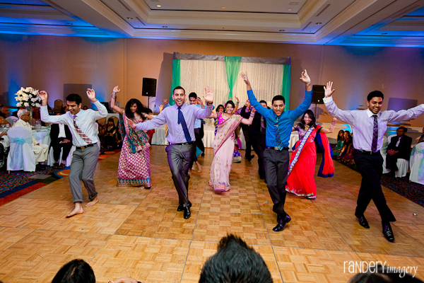 Indian wedding tradition includes a dance performance for the Indian bride and groom.