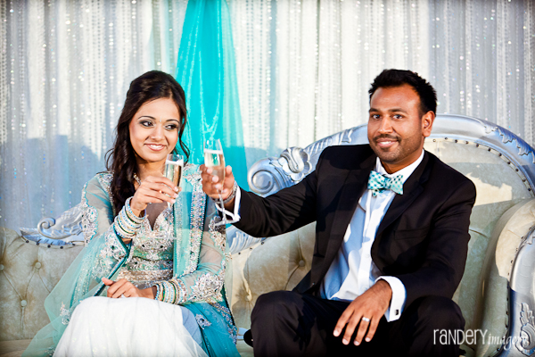 An Indian bride and groom toast at their Indian wedding reception.
