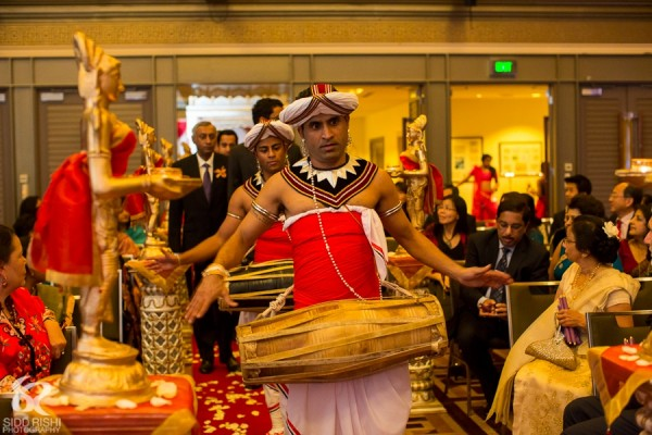 Performers attend this indian wedding ceremony.