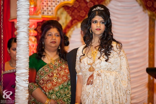 An Indian bride is a white bridal sari.