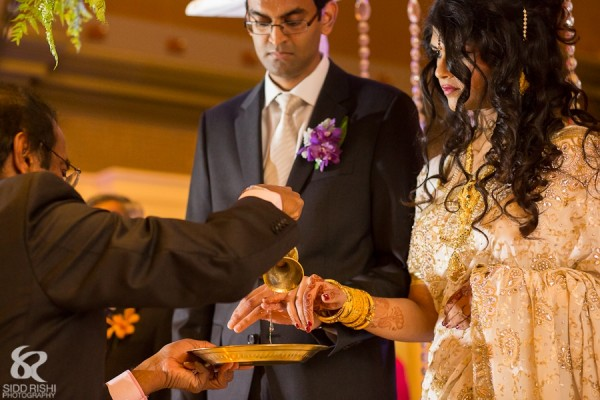 An Indian bride and groom at a fusion Indian wedding.