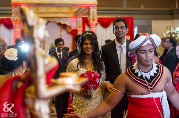 An Indian bride and groom leave their fusion indian wedding.