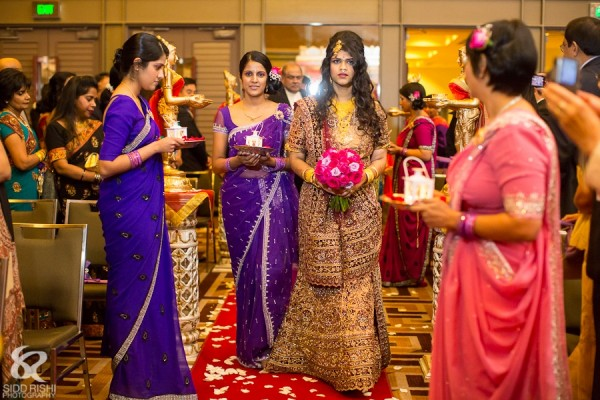 An Indian bride wears a traditional sari at her Hindu Indian wedding.