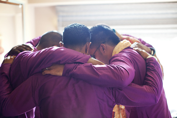 The groomsmen make a huddle before the Indian wedding march begins.