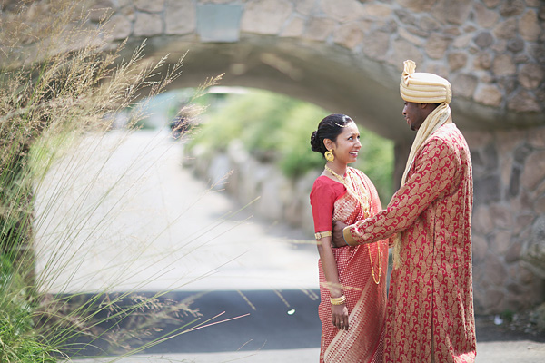 A groom gets the first look of his Indian bride.