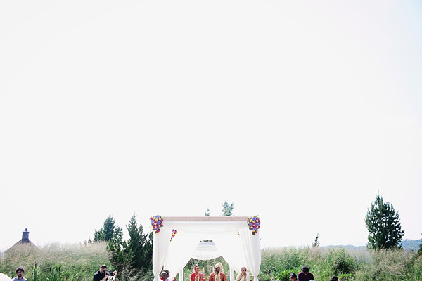 Indian wedding photography captures the lovely scene of this outdoor affair.