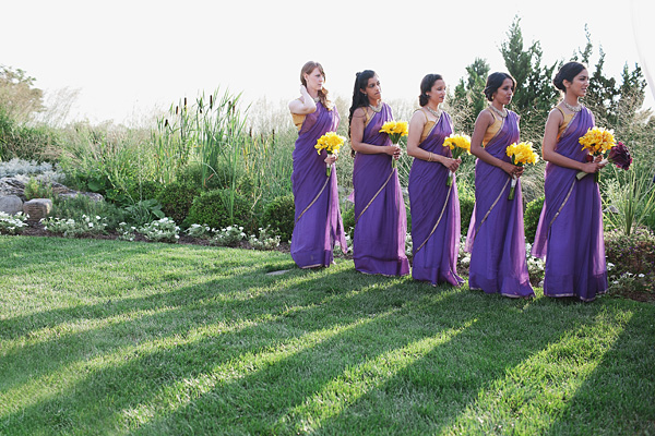 Bridesmaids wear a purple bridal sari for this fusion Indian wedding.
