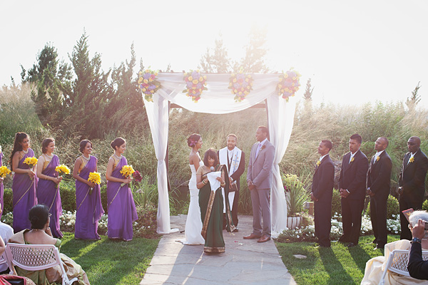 An Indian bride and groom celebrate at this fusion Indian wedding.