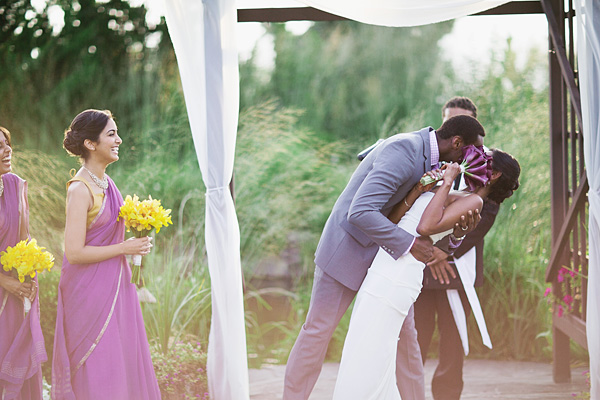 An Indian bride and groom kiss at this fusion Indian wedding.