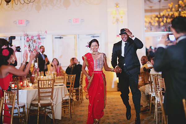 An Indian bride and groom enter their fusion Indian wedding reception.
