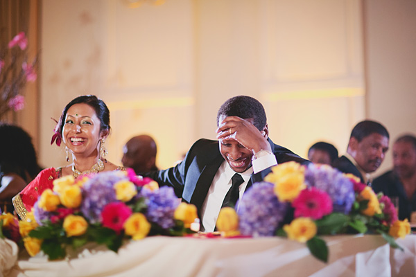 Indian wedding photography captures a happy moment at a fusion Indian wedding reception.