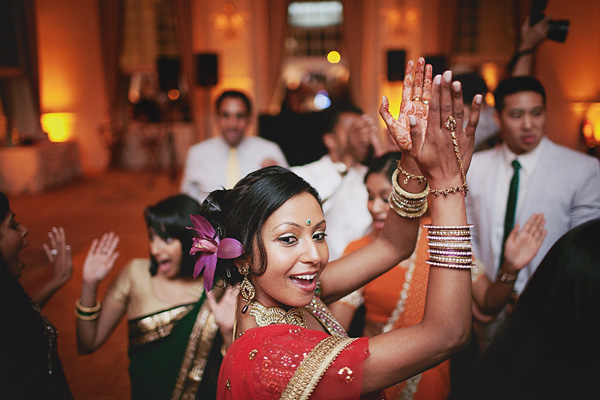 An Indian bride dances at her fusion Indian wedding reception.