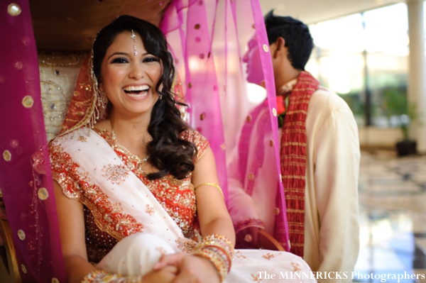 Indian bride in a palanquin to enter her indian wedding.