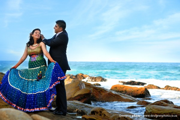 An Indian bride and groom with their beachside engagement photos.