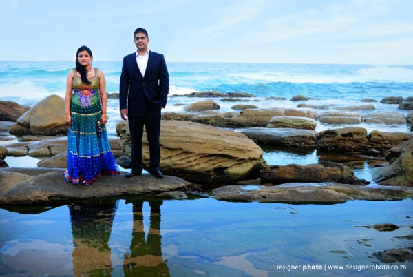 An Indian bride and groom in modern Indian outfits.