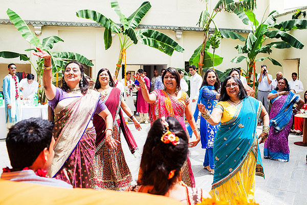 A bridal mehndi party features dancing entertainment in Udaipur, India.