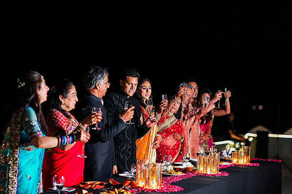Family and friends toast to newlyweds at this Indian wedding reception in Udaipur, India.