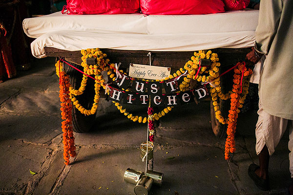 "A camel cart reads ""just hitched"" as it waits to take away an Indian bride and groom."