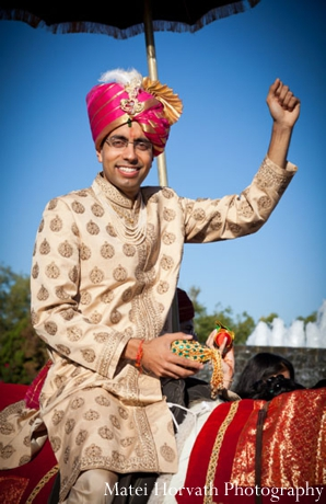 An Indian groom arrives to his Indian wedding at a baraat.