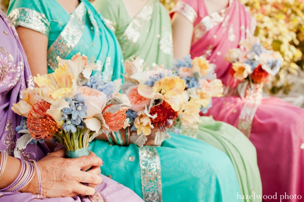 Indian wedding ideas include bright bridal saris and colorful wedding bouquets.