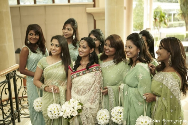 An Indian bride and her bridesmaids wear green bridal sarees at this Indian wedding.