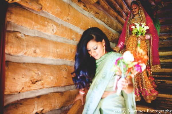 An indian bride and her bridesmaid about to attend the indian wedding ceremony.