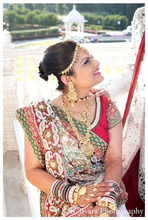 an indian bride in her traditional bridal lengha and indian bridal jewelry.