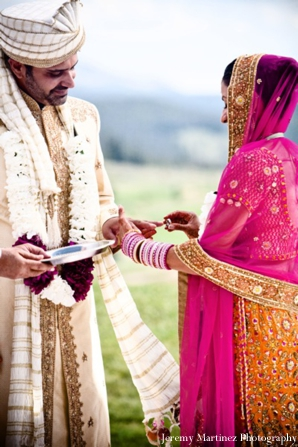 An Indian bride exchanges vows with her Indian groom.
