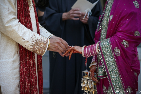 A groom marries his Sikh Indian bride, who wears a hot pink bridal sari.