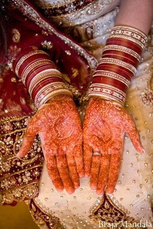 Indian bride shows off bridal mehndi.