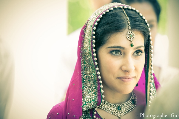 Sikh Indian bride in an Indian jewelry set in diamonds and emeralds.