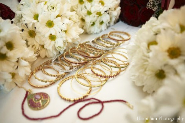 Indian bridal jewerly set includes these gold arm bangles.