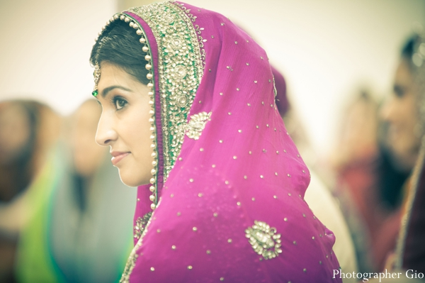 A Sikh Indian bride in a hot pink wedding sari.
