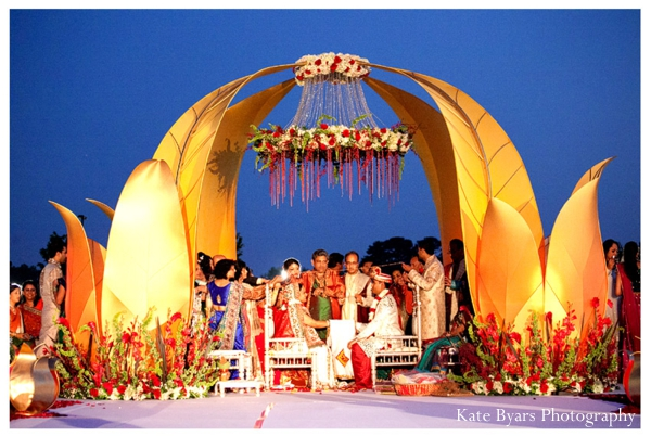 Floral decorations under a modern mandap at this indian wedding.