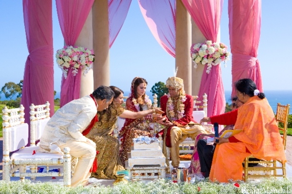 Indian bride and groom wed in an outdoor Indian wedding ceremony.