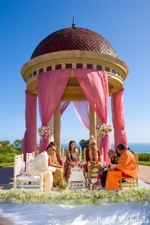 Domed mandap for an outdoor Indian wedding.