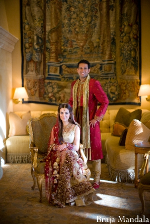 indian bride and groom wedding portrait inside resort hotel.