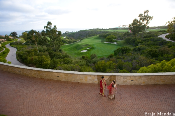 Aerial shot of indian bride and groom at outdoor indian wedding venue.