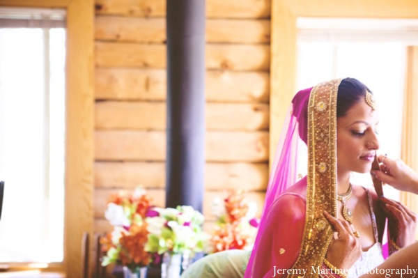 An indian bride gets ready for her outdoor indian wedding.