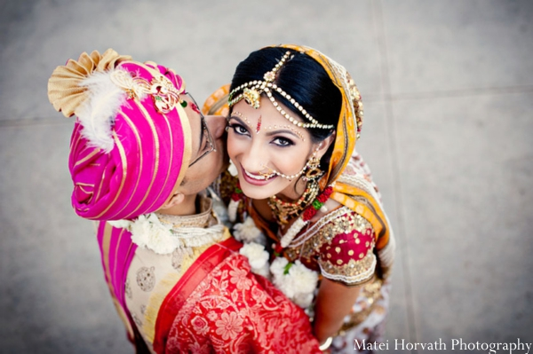 An Indian bride wears a tikka, a traditional Indian bridal jewelry for the head.