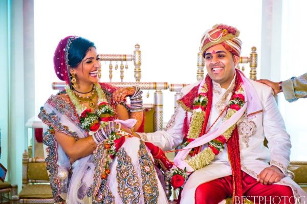 An Indian bride and groom in their traditional Indian wedding clothing.