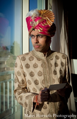 An Indian groom in traditional wedding outfit.