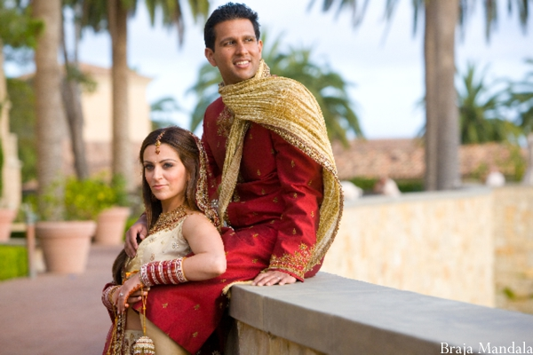 An Indian bride and groom at their outdoor indian wedding.
