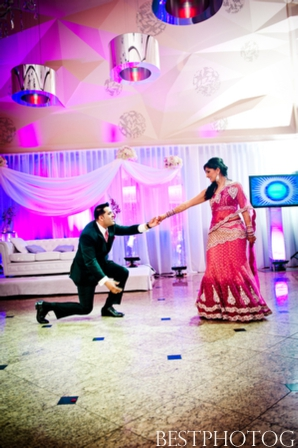 An Indian bride and groom twirl on the dancefloor of their Indian wedding reception.