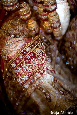 Indian wedding photography shows close up of bridal lengha.