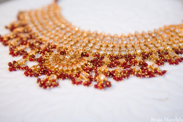 Bridal indian wedding jewelry in red and gold.