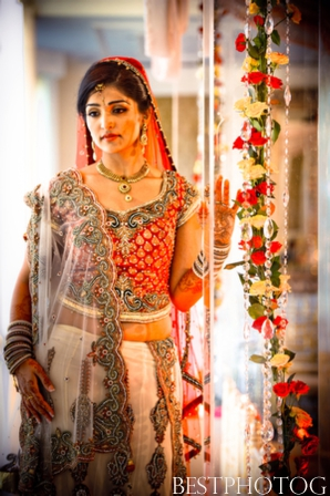 An Indian bride wears a traditional bridal lengha.