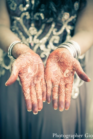 Indian wedding photography shows close up of bridal mehndi.